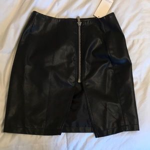 Super cute faux leather skirt, never worn!